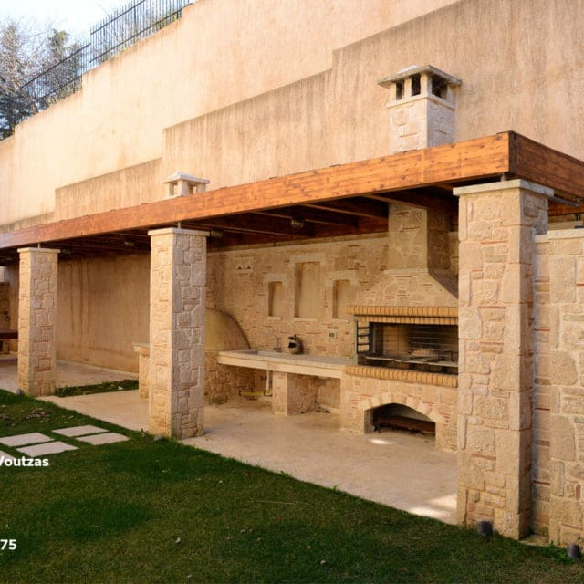 Villa Marina Neos Voutzas - Rear Garden (south) with BBQ, stone oven and dining table