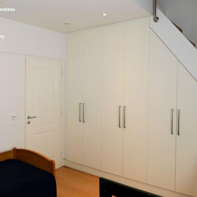 Villa Marina Neos Voutzas - Third floor. The closet and the stairs leading to the loft
